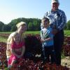 Three generations of the Jersey Legacy family in the lettuce field. 2014
